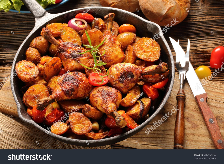 Roasted Chicken Legs Baked Potato On Stock Photo Edit Now