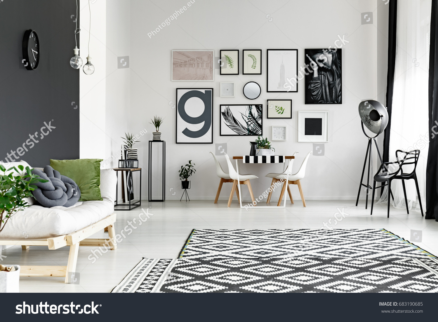 black and white walls in spacious living room with dining table