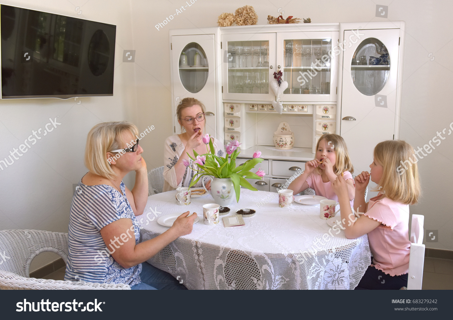 three family generations sit around the kitchen table and enjoy the freshly baked waffles the twin three family generations sit around kitchen stock photo 683279242      rh   shutterstock com
