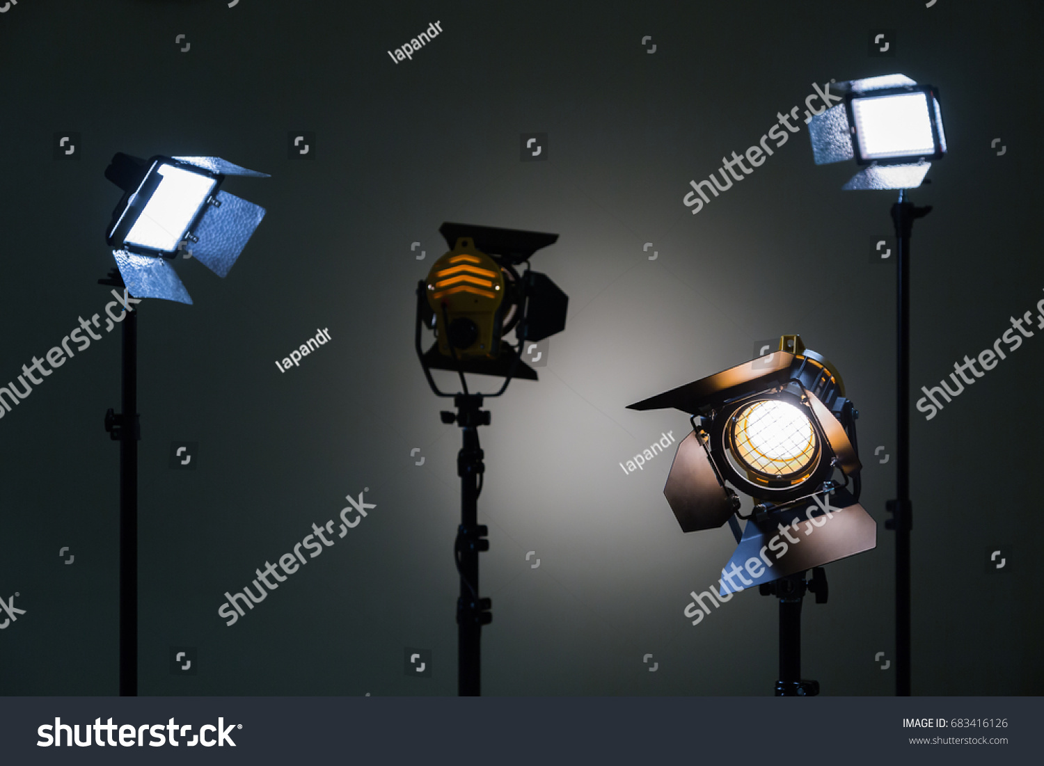 Two Floodlights With Halogen Lamps And Fresnel Lens And Two Led Lighting  Device. Shooting In