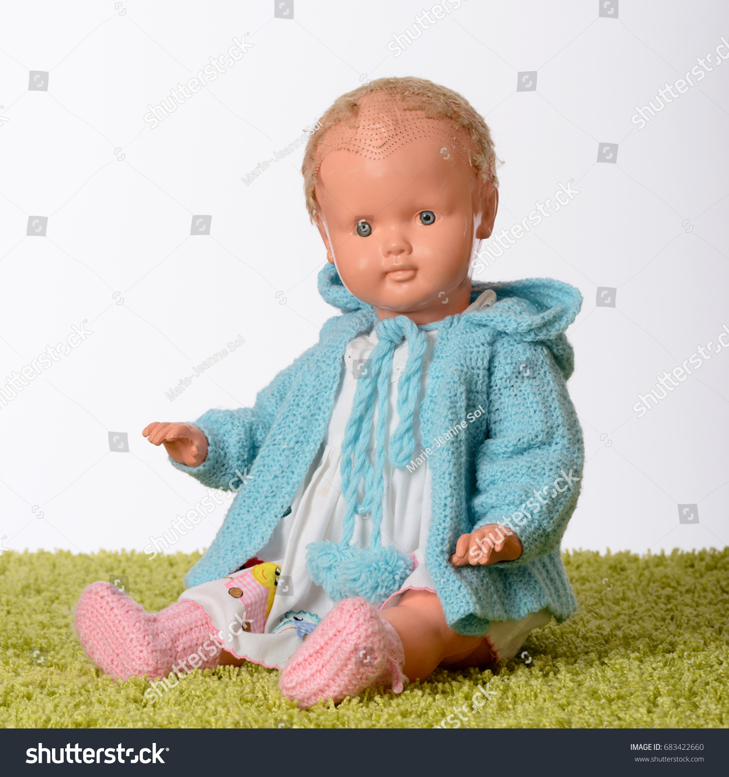 6515a1b09d71 Old Doll On Green Carpet Blue Stock Photo (Edit Now) 683422660 ...