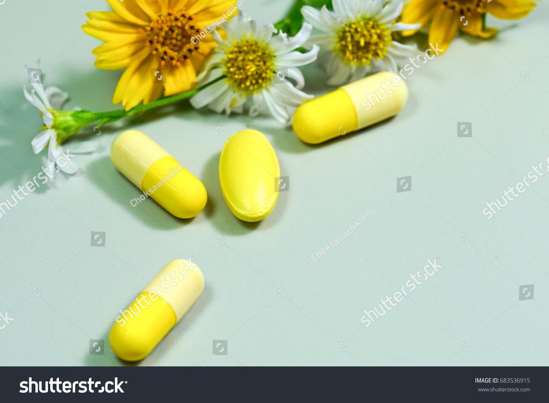 Medicine pills yellow white flower stock photo royalty free medicine pills with yellow and white flower mightylinksfo
