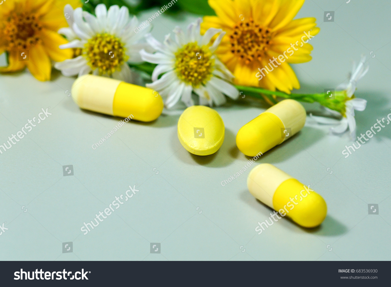 Medicine pills yellow white flower stock photo edit now 683536930 medicine pills with yellow and white flower mightylinksfo
