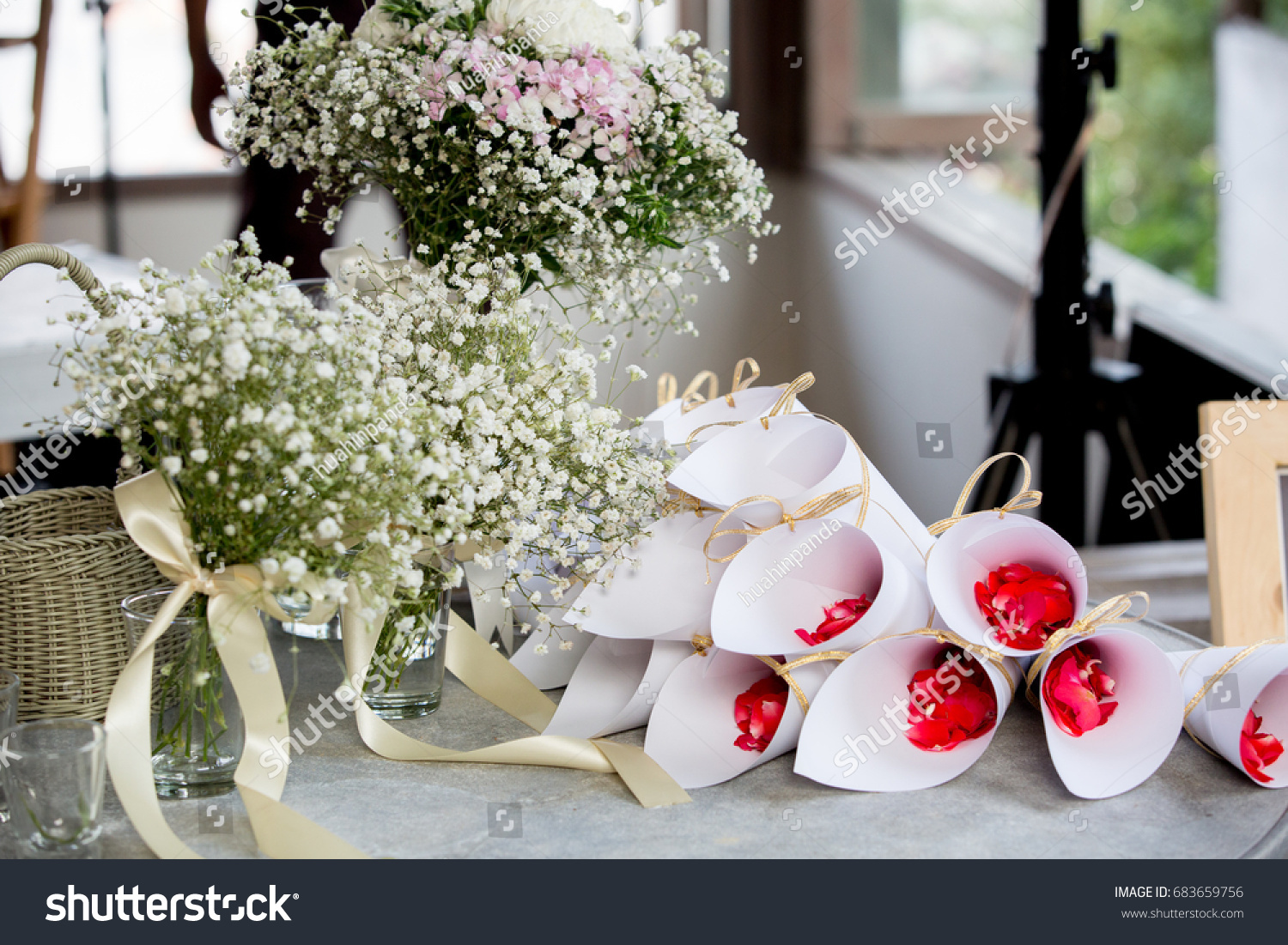 Red rose petals white paper cones stock photo edit now 683659756 red rose petals in white paper cones and flower bouquet preparation for the wedding ceremony mightylinksfo