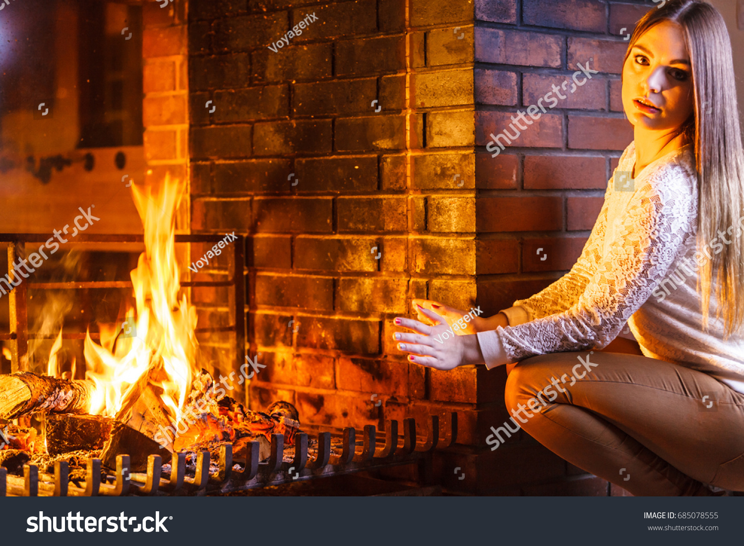 woman warming hands fireplace young stock photo 685078555