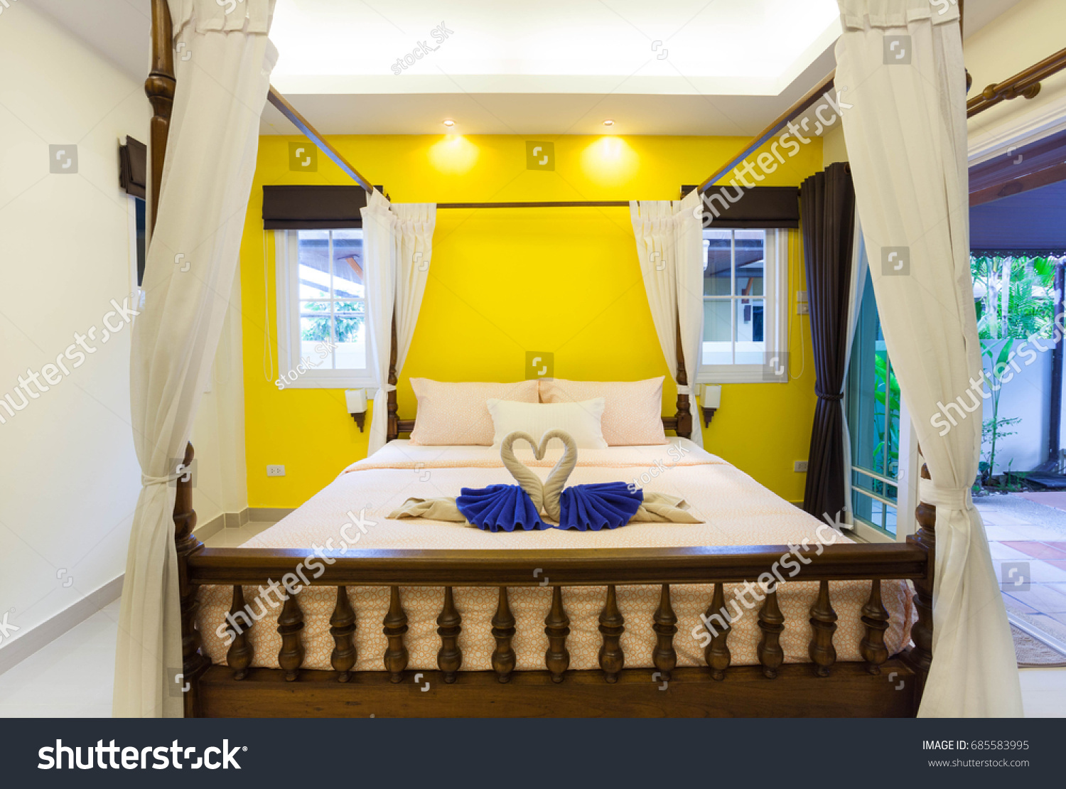 House design yellow - Interior Design Of Master Bedroom In Luxury Cozy House It Feature Yellow Wall Raised