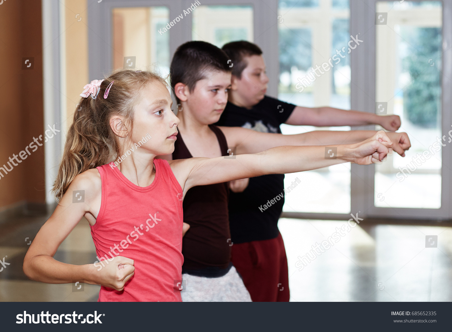 Children are training punch the hand #685652335