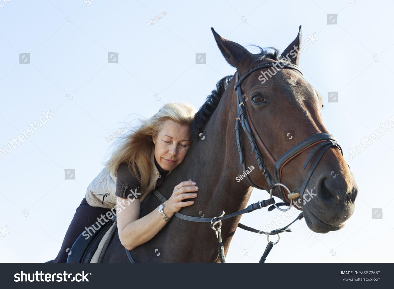 mature woman long blond hair riding stock photo 685872682 - shutterstock