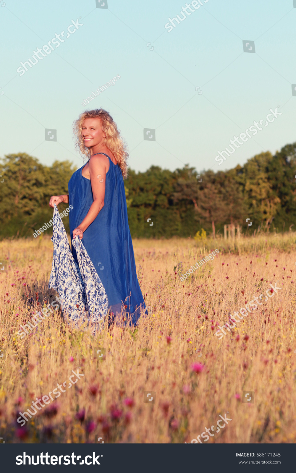 happy mature woman playing big shawl stock photo 686171245