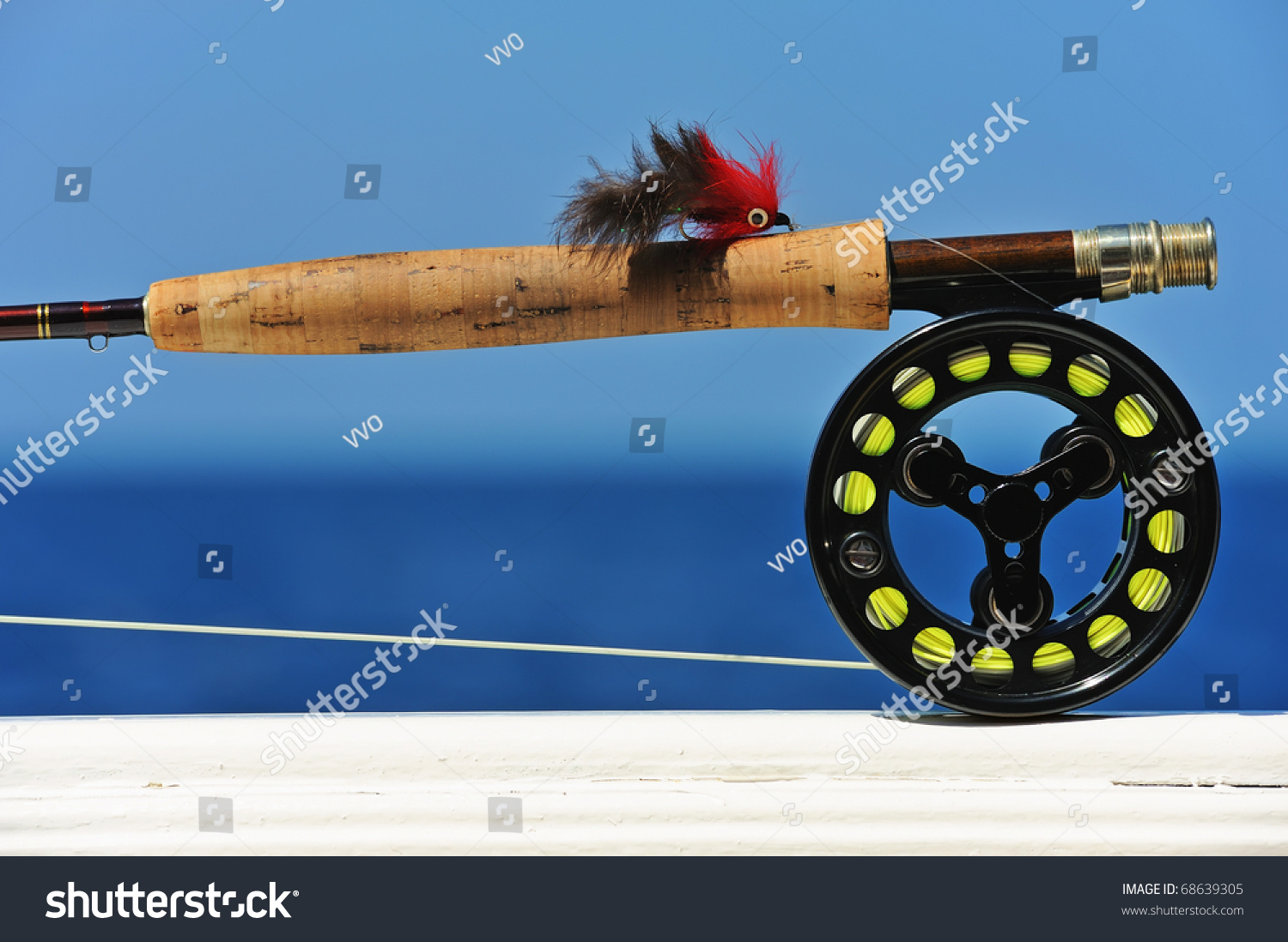 close up shot of saltwater fly fishing tackle against sea stock, Fishing Reels