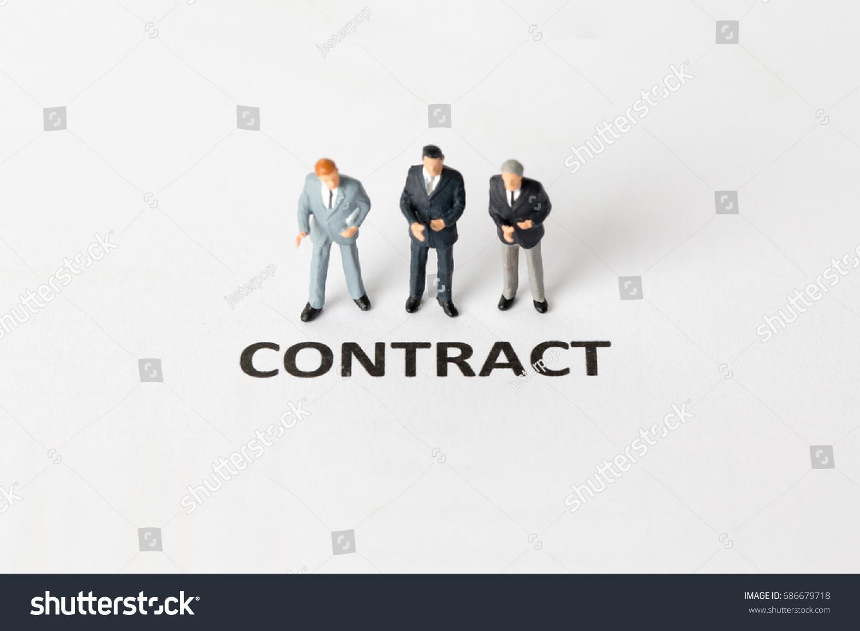 Miniature Model Businessman Standing Contract Wording Stock Photo
