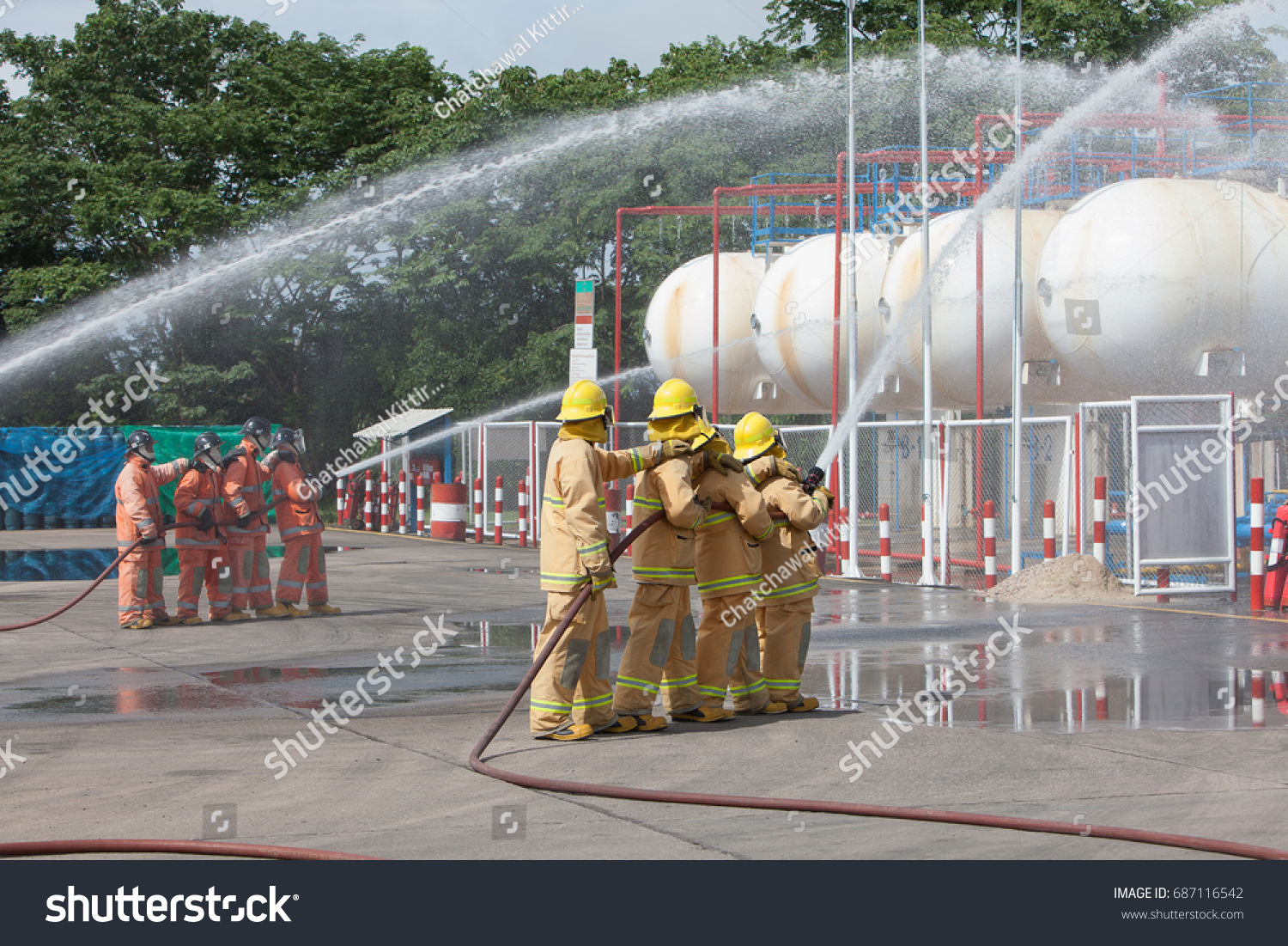 Firefighter Water Spray By High Pressure Stock Photo (Edit