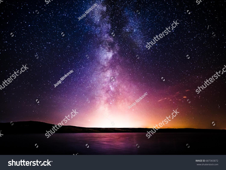 Milky Way over the sea #687365872