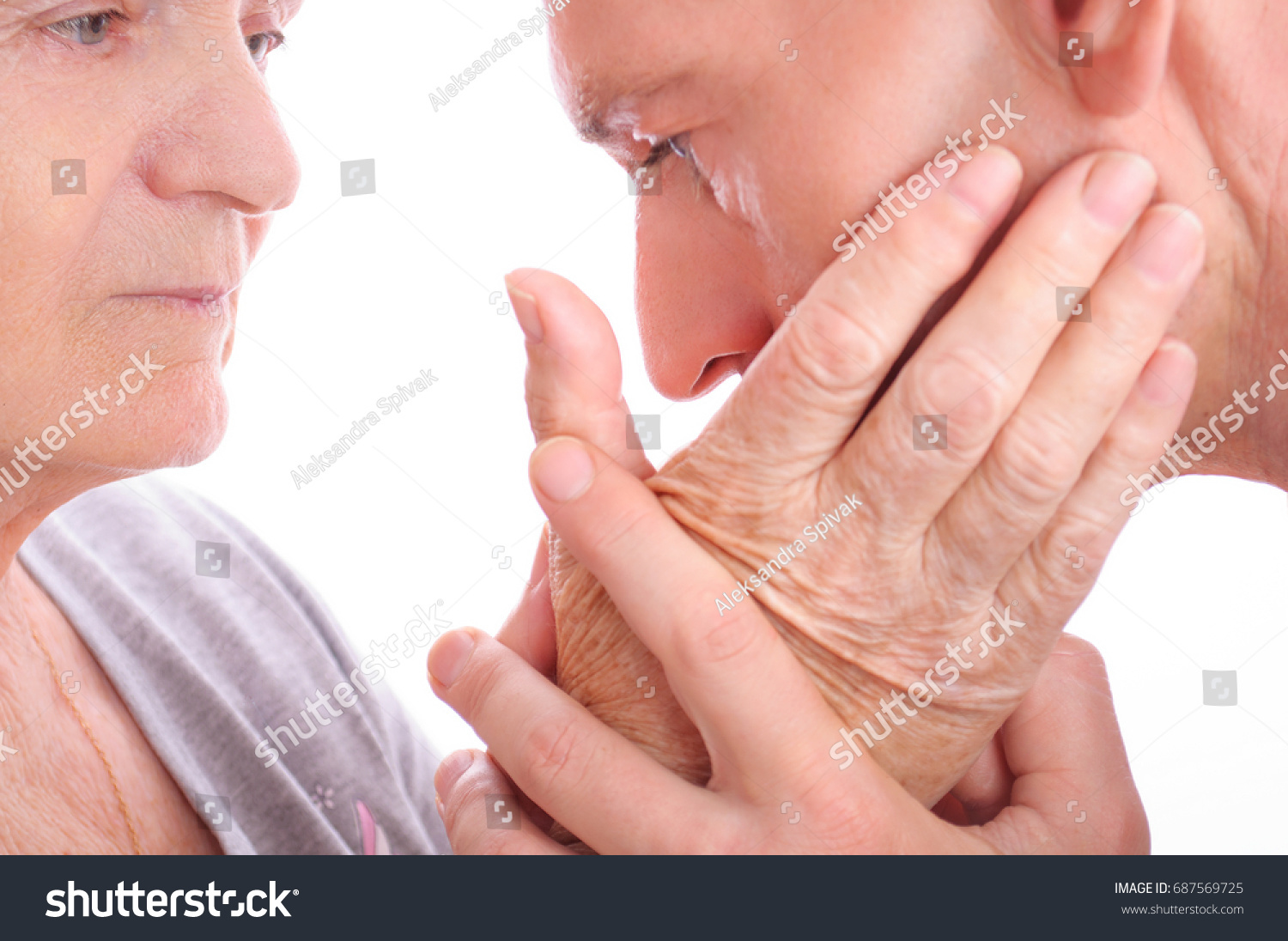 Close up image of hands. Adult son holding his aged mother hands. Concept: