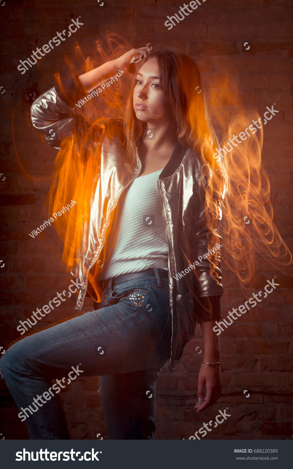 Beautiful brunette woman in shiny silver jacket and blue jeans. Mixed lighting photography & Beautiful Brunette Woman Shiny Silver Jacket Stock Photo 688220389 ... azcodes.com