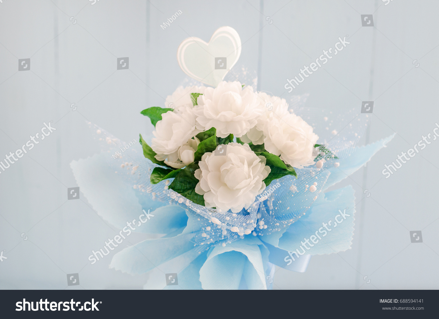 Artificial jasmine flower bouquet blue ribbon stock photo royalty artificial jasmine flower bouquet with blue ribbon bow on white and blue wooden background jasmine izmirmasajfo Image collections