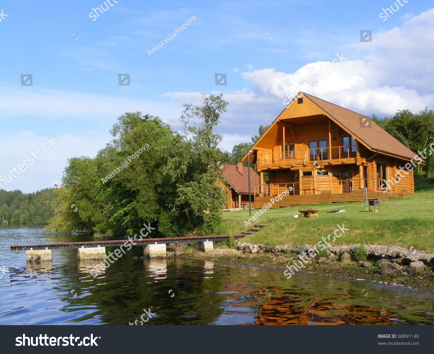 Beautiful Wooden House Near River Stock Photo 68891140