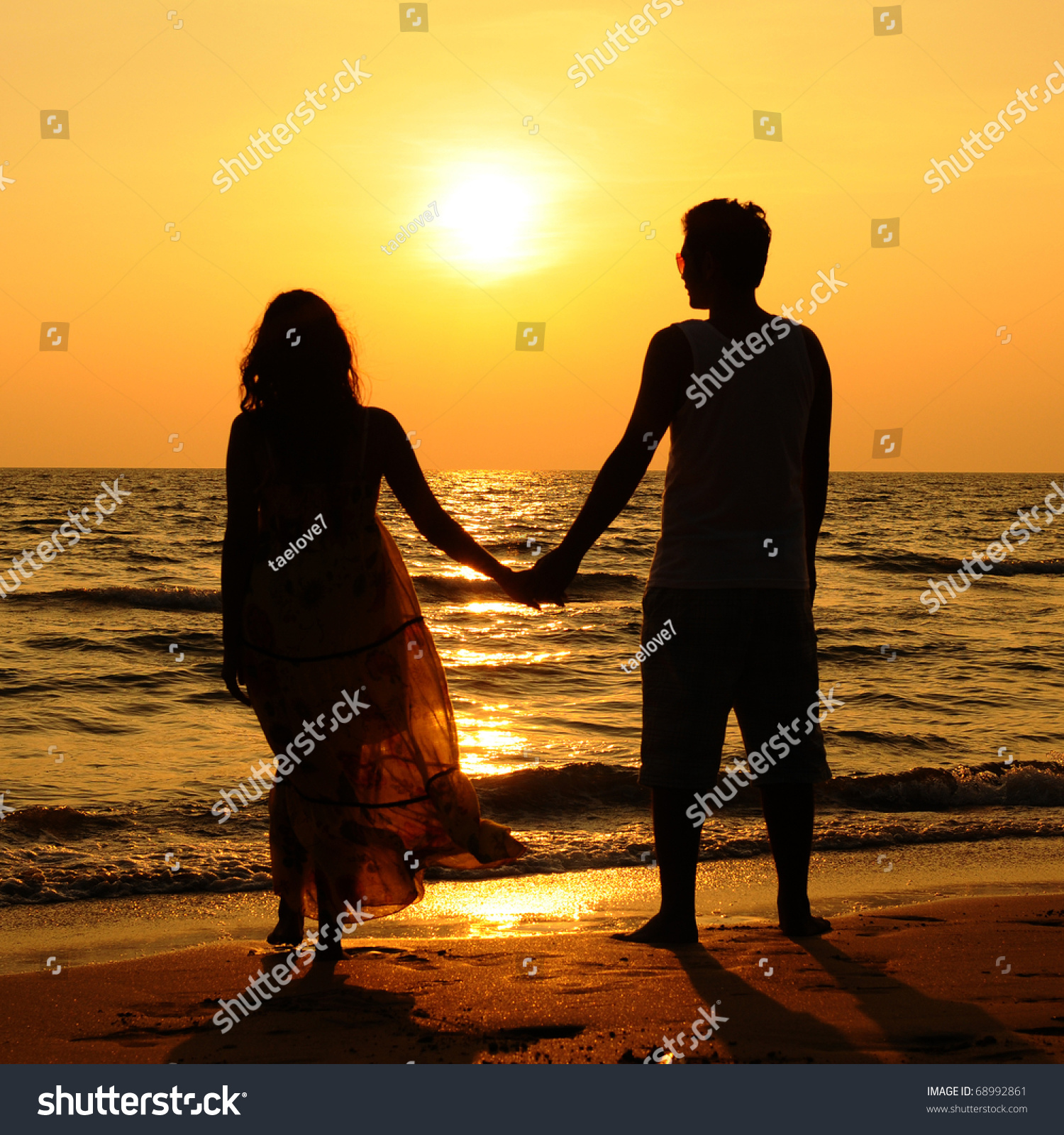 Couple Silhouette On Beach Sunset Stock Photo 68992861