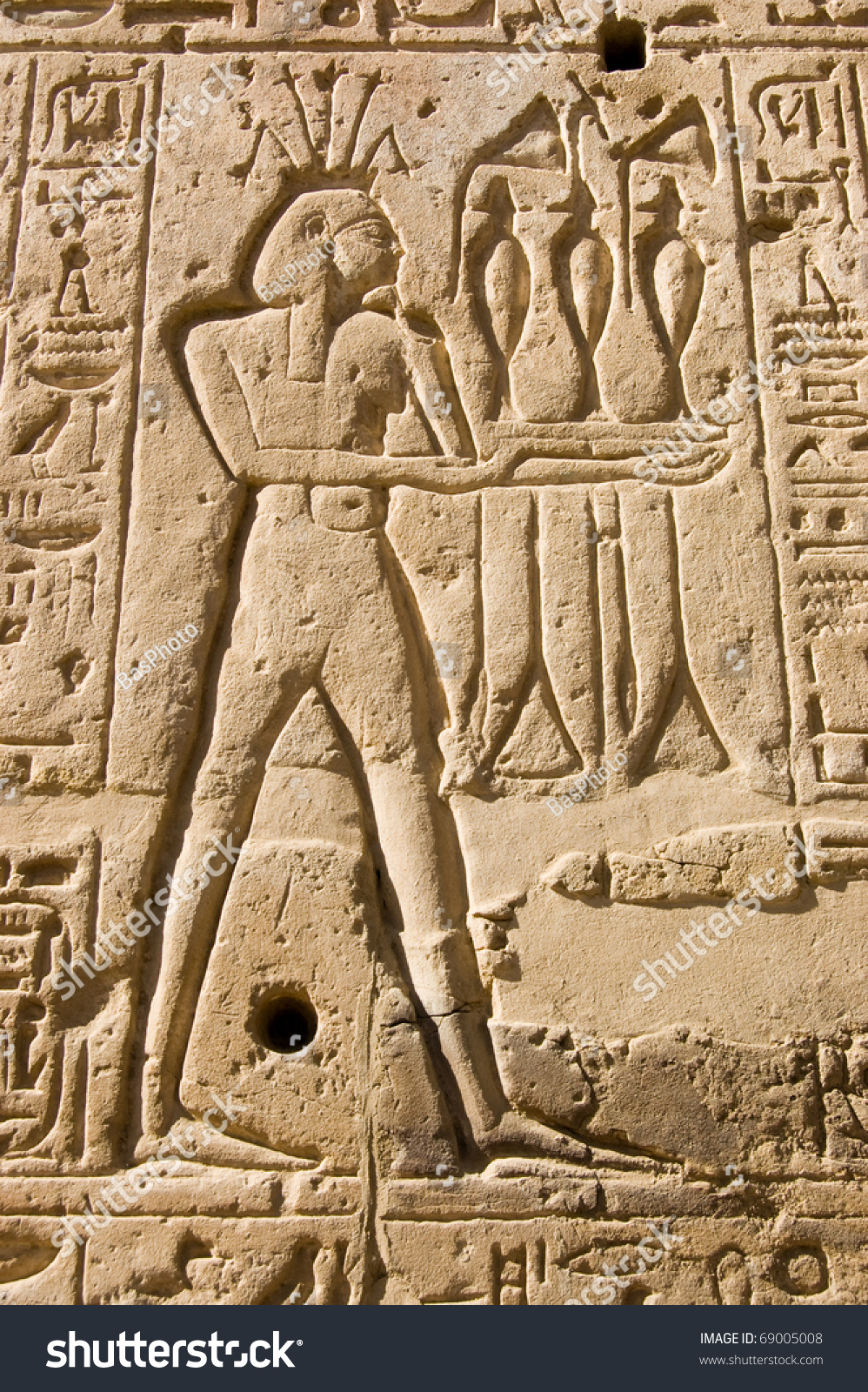 Stone carving ancient egyptian god river stock photo edit now stone carving of the ancient egyptian god of the river nile hapi shown wearing a izmirmasajfo