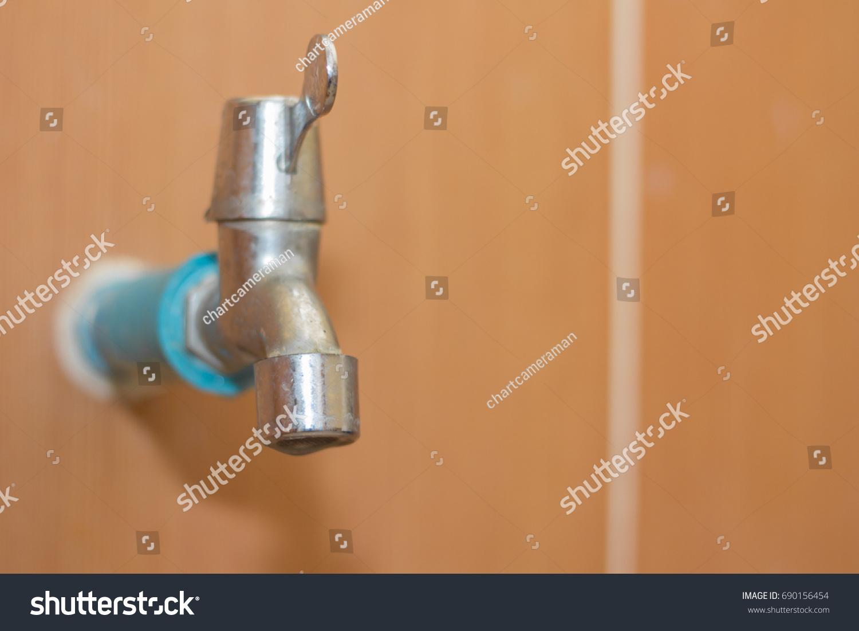 Water Drop Running Faucet On Orange Stock Photo (Edit Now)- Shutterstock