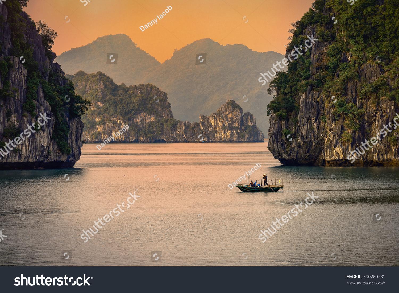 Halong bay boats,Sunset at Ha Long Bay scenic view , Hanoi, Vietnam #690260281