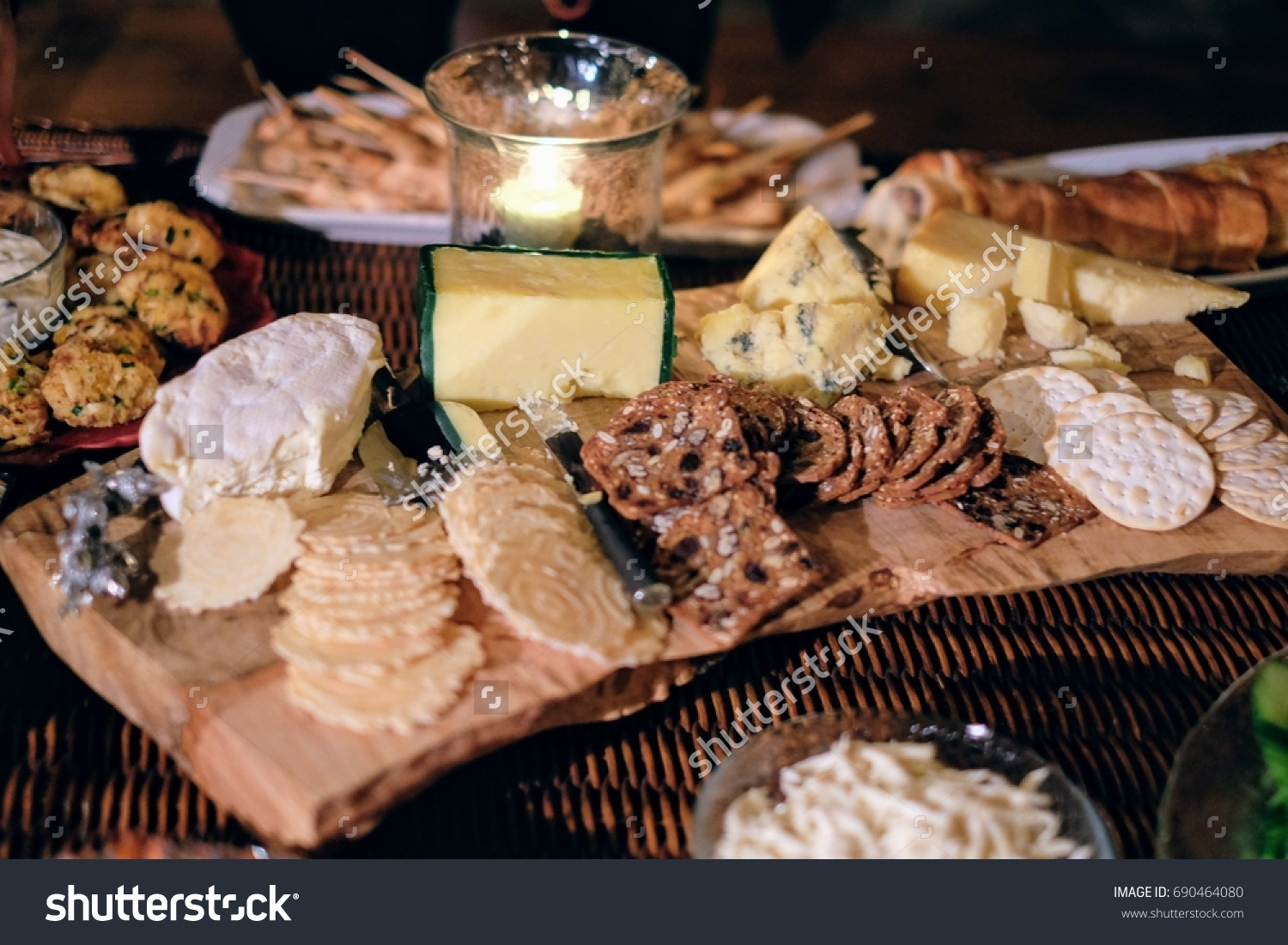 Fancy cheese plate selection & Fancy Cheese Plate Selection Stock Photo 690464080 - Shutterstock
