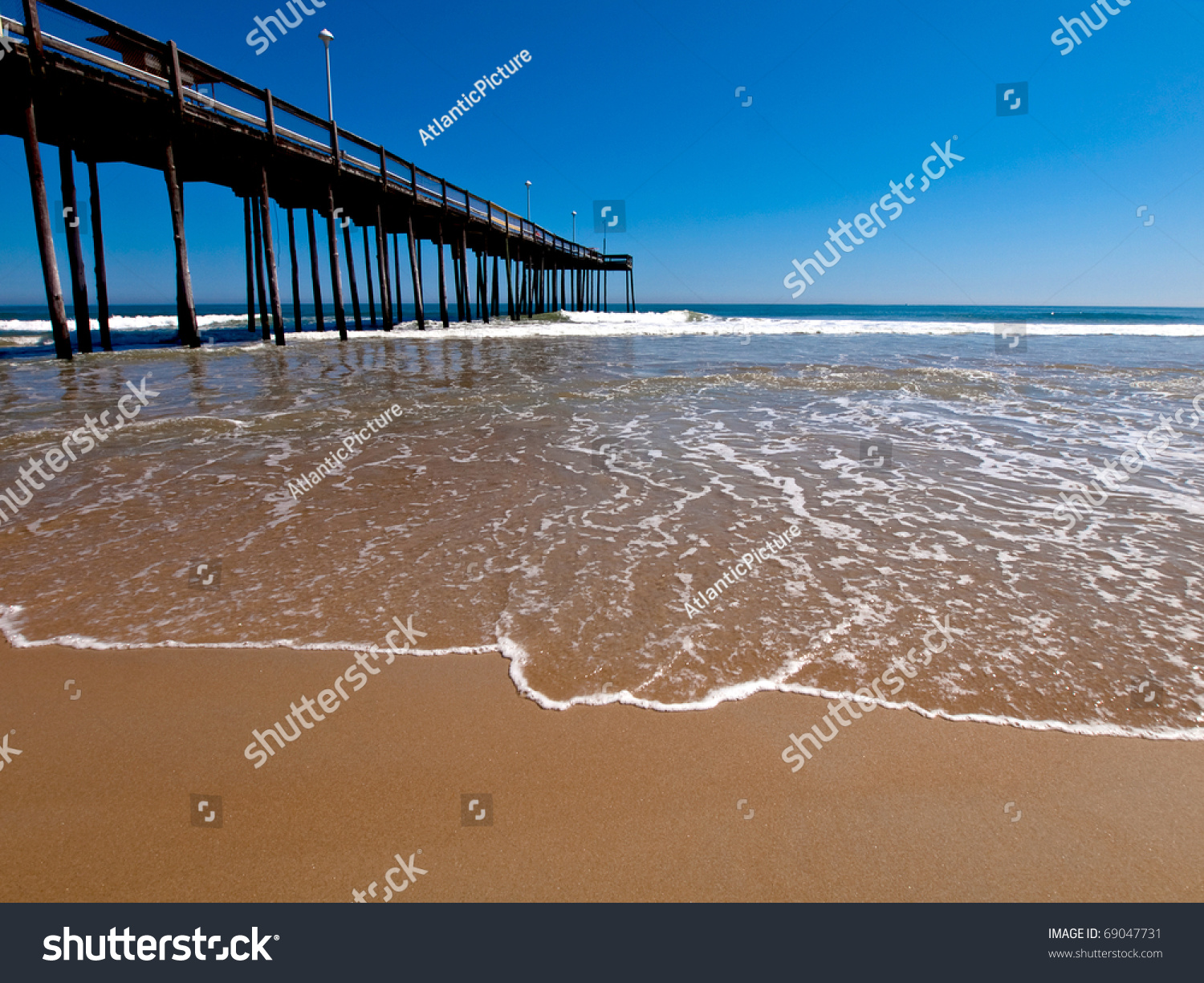 Ocean city maryland fishing pier at the sandy sunny beach for Maryland fishing piers