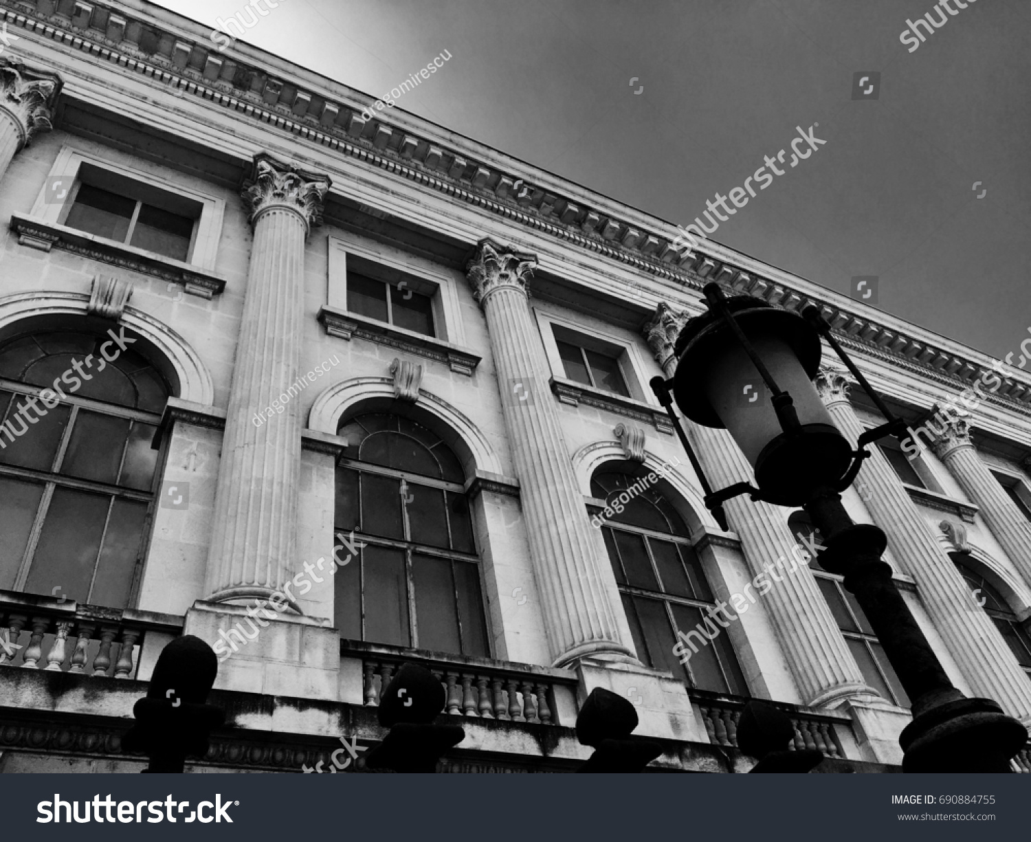 Black and white photography architectural architecture detail historical building with street lamp