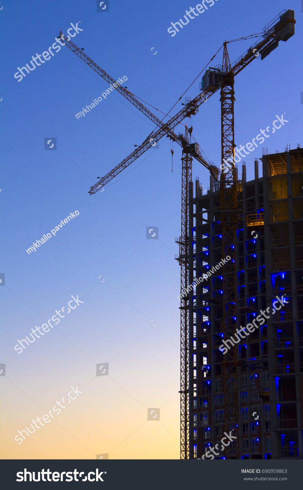 construction highrise building tower crane closeup stock photo