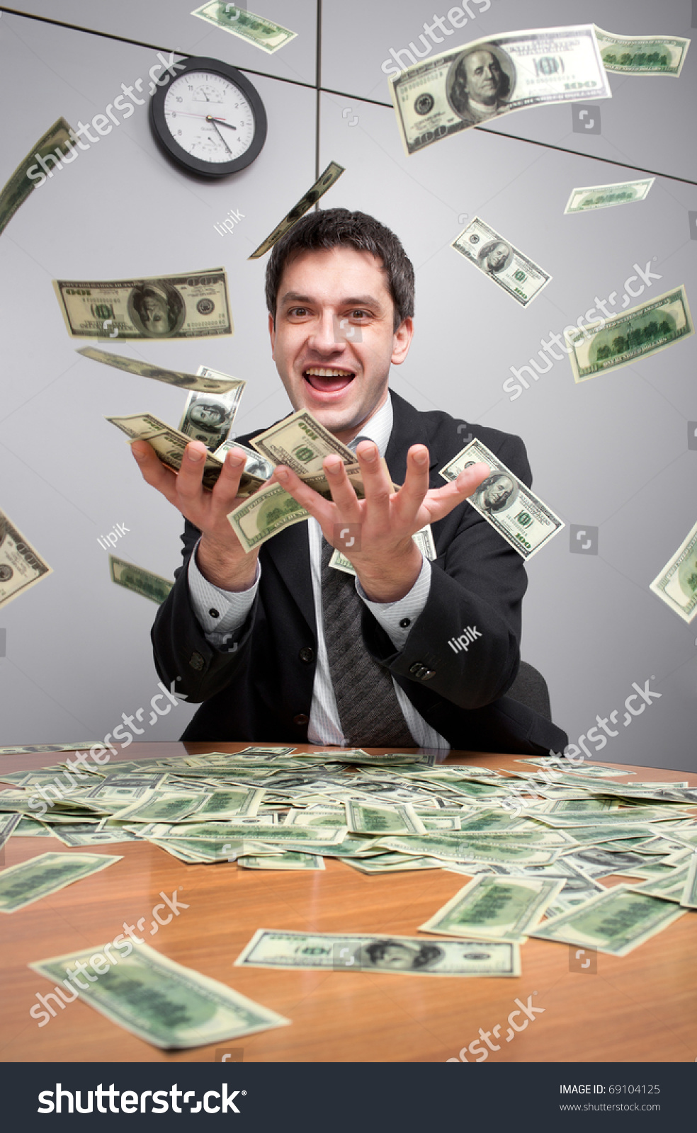 young businessman office catch money air stock photo  young businessman in office catch a lot of money in the air