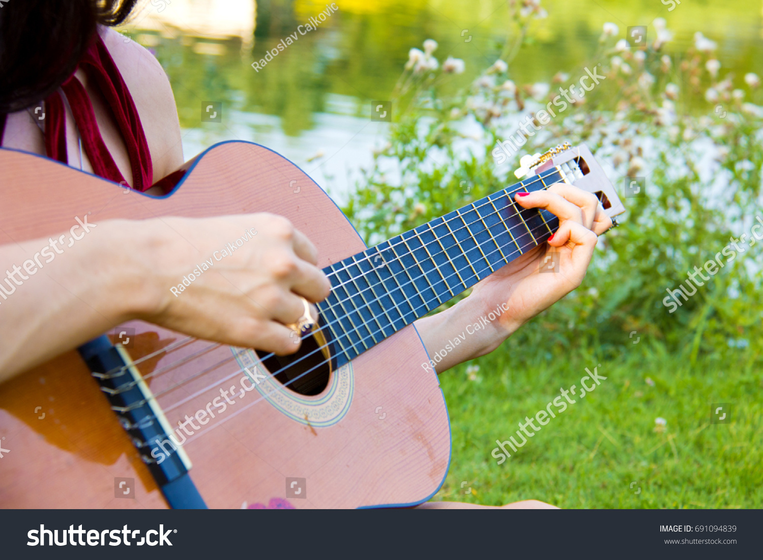 Female Hands Holding Chords Playing Guitar Stock Photo Edit Now