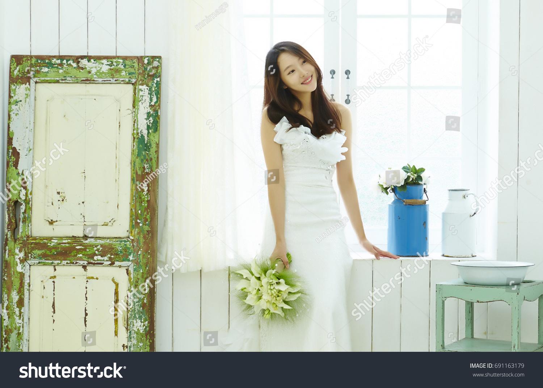 Korean Woman Wedding Dress Holding Flower Stock Photo Edit Now