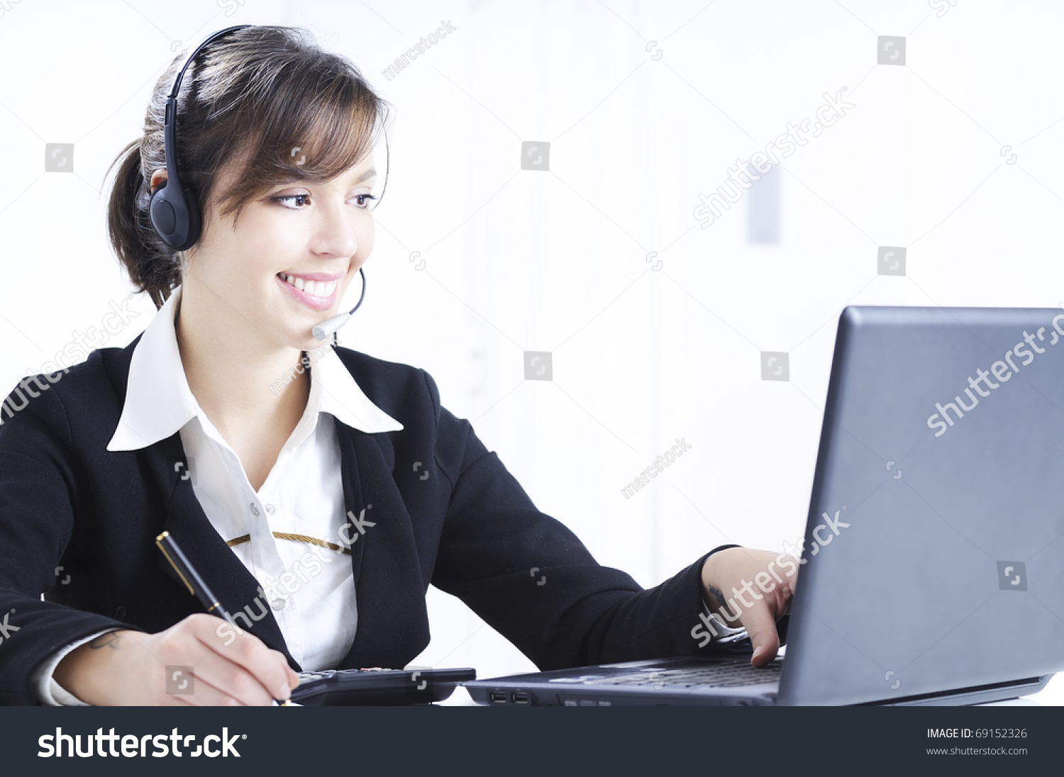 young w working office laptop headphones stock photo  young w working in office laptop and headphones customer service and call center