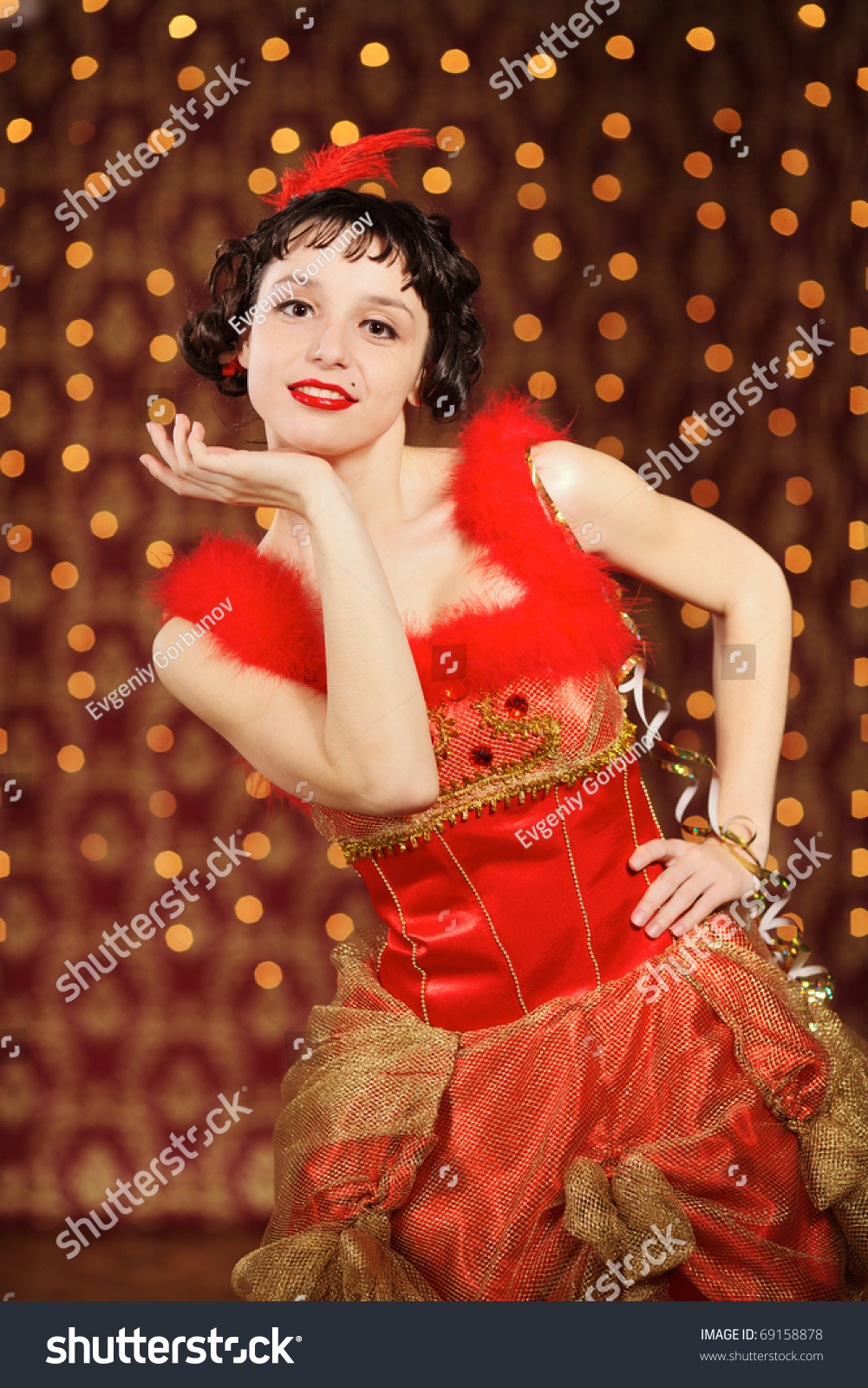 lady in red dress at the carnival stock photo 69158878 shutterstock. Black Bedroom Furniture Sets. Home Design Ideas