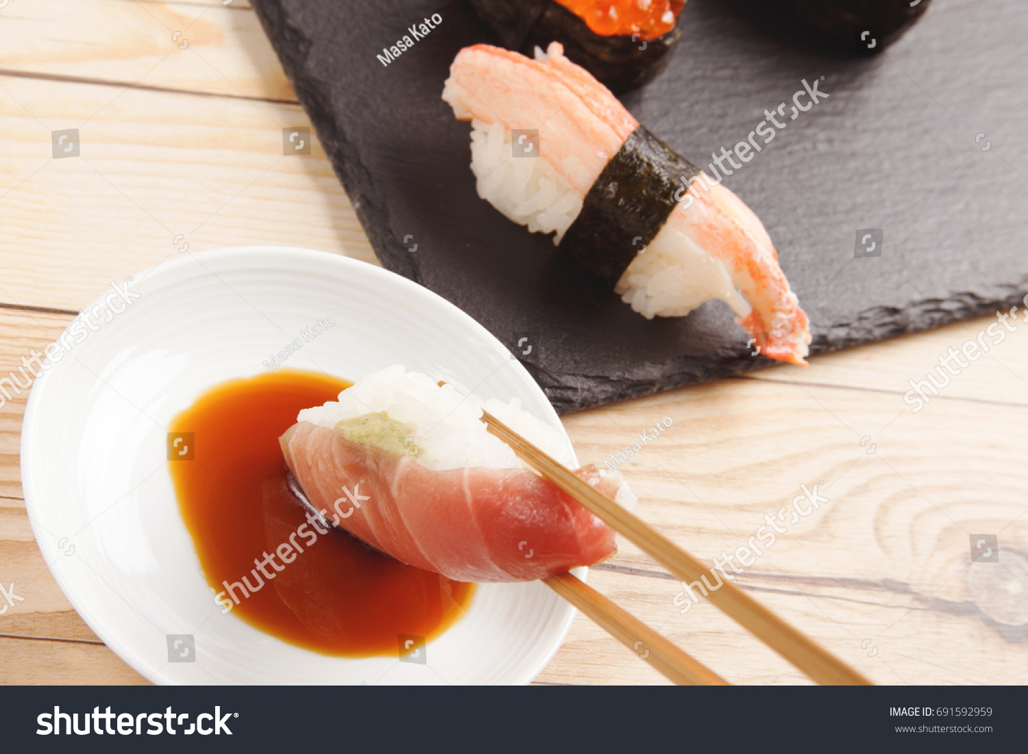 Tuna Sushi Dipping Soy Sauce Stock Photo Edit Now 691592959