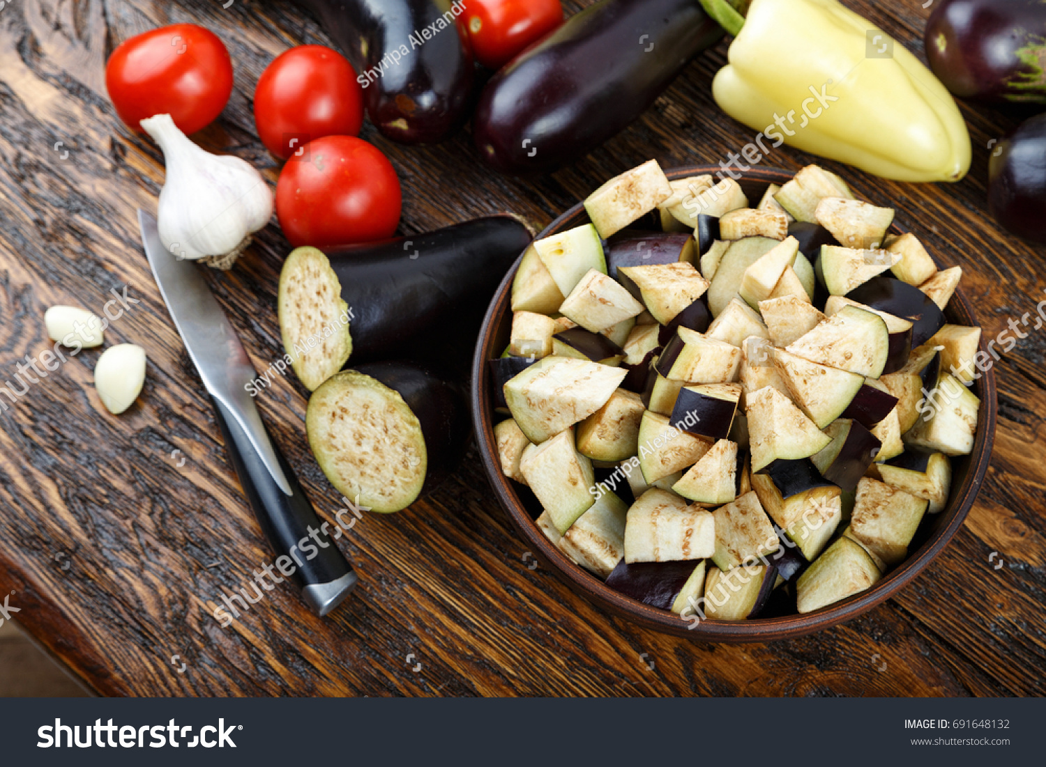 Raw diced eggplant bowl tomato garlic stock photo royalty free raw diced eggplant in a bowl tomato and garlic detail of a cut raw forumfinder Images