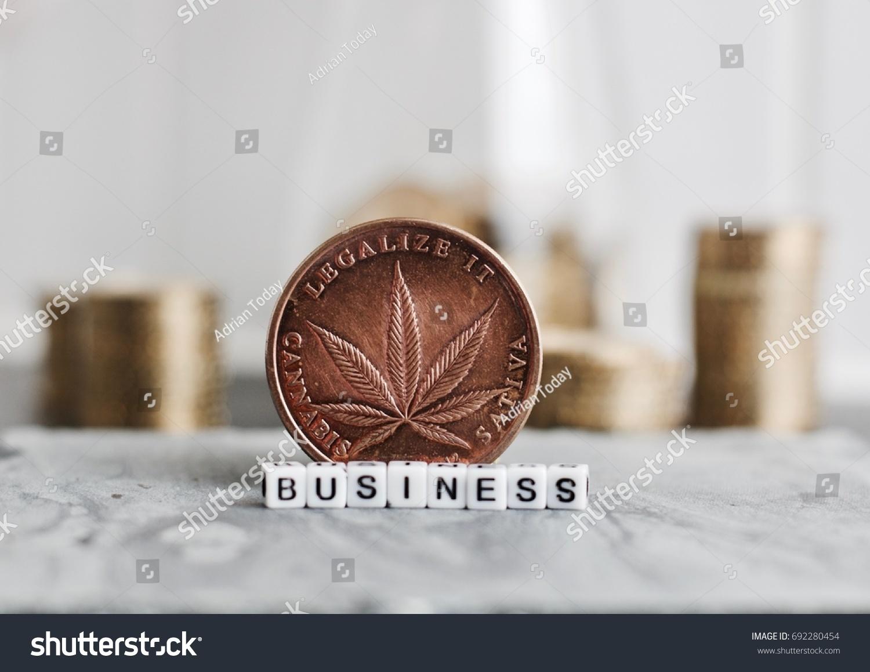 Brass big marijuana coin cannabis leaf stock photo 692280454 brass big marijuana coin with cannabis leaf near business inscription biocorpaavc Images