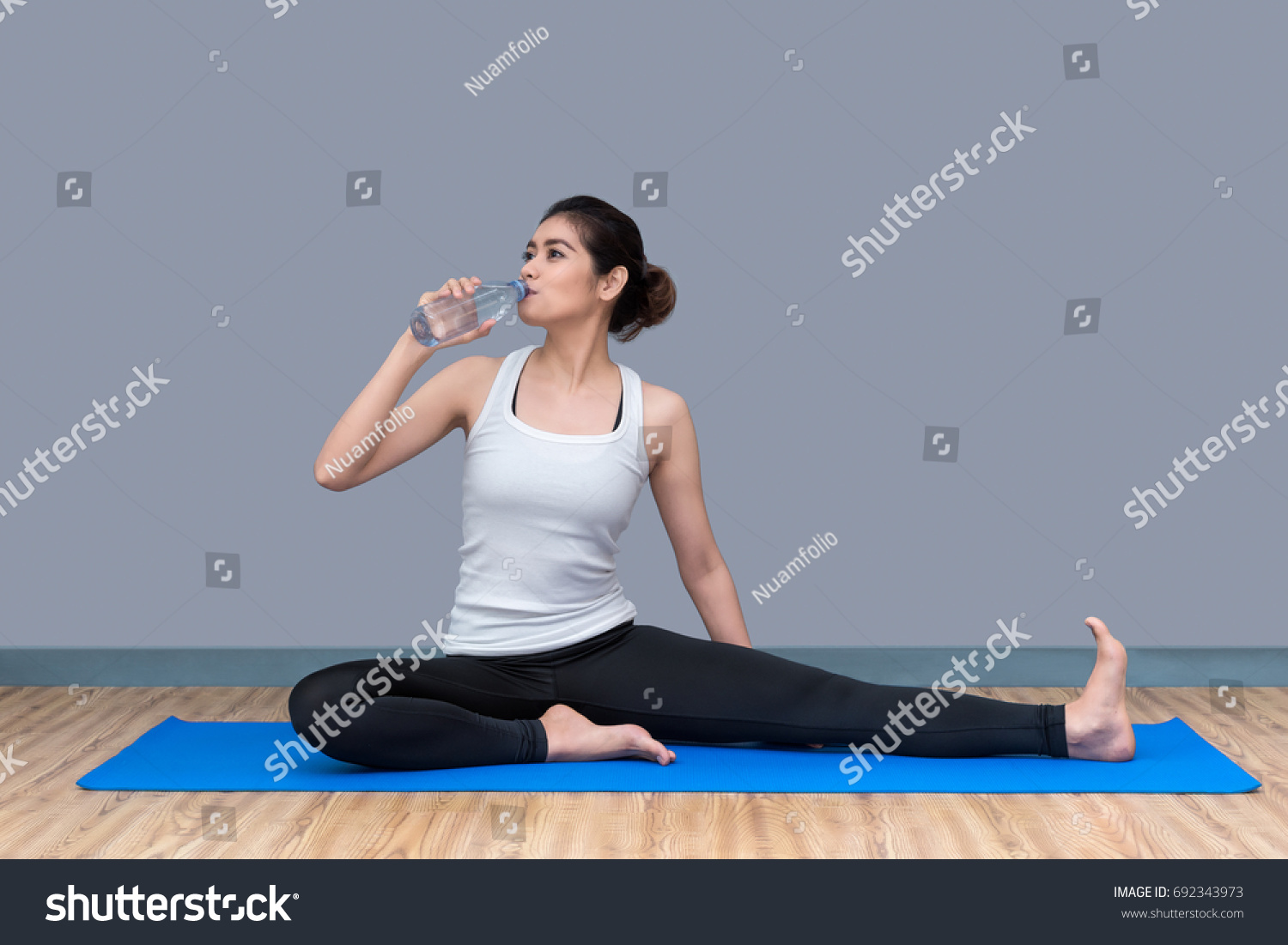 Young asian woman drink water after stock photo 692343973 young asian woman drink water after finish workout at healthy sport gymoto concept for sciox Gallery