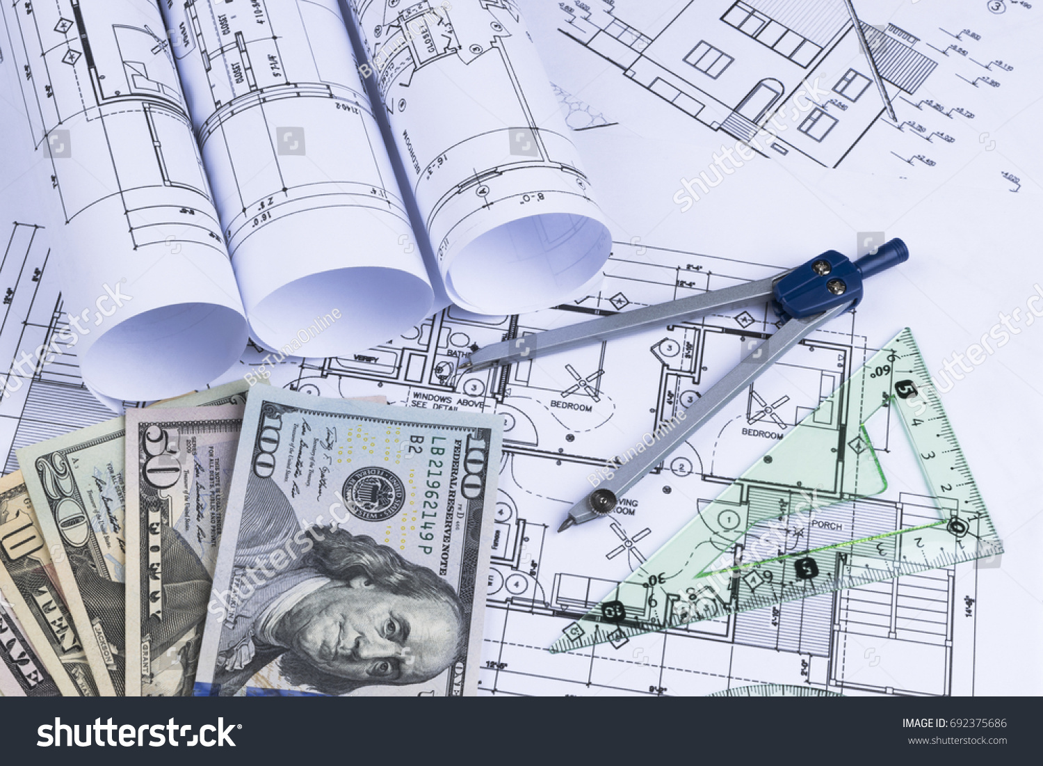 Blueprint architect money symbolic photo financing stock photo a blueprint of an architect with money symbolic photo for financing and planning of a malvernweather Gallery