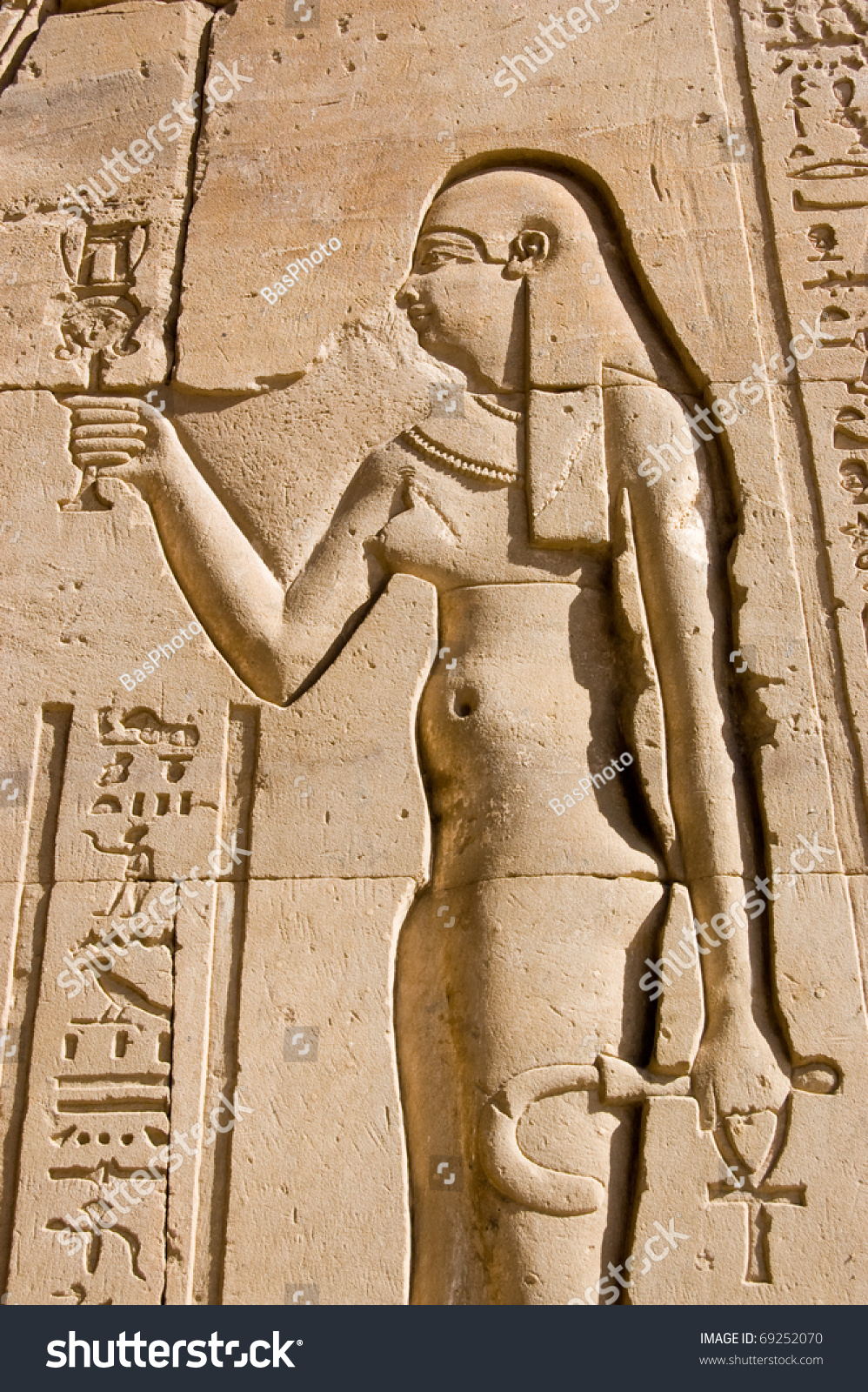 Carving ancient egyptian queen cleopatra wall stock photo