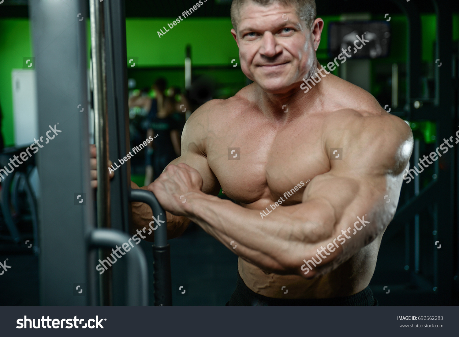 Brutal Strong Athletic Men Pumping Muscles Stock Photo (Edit