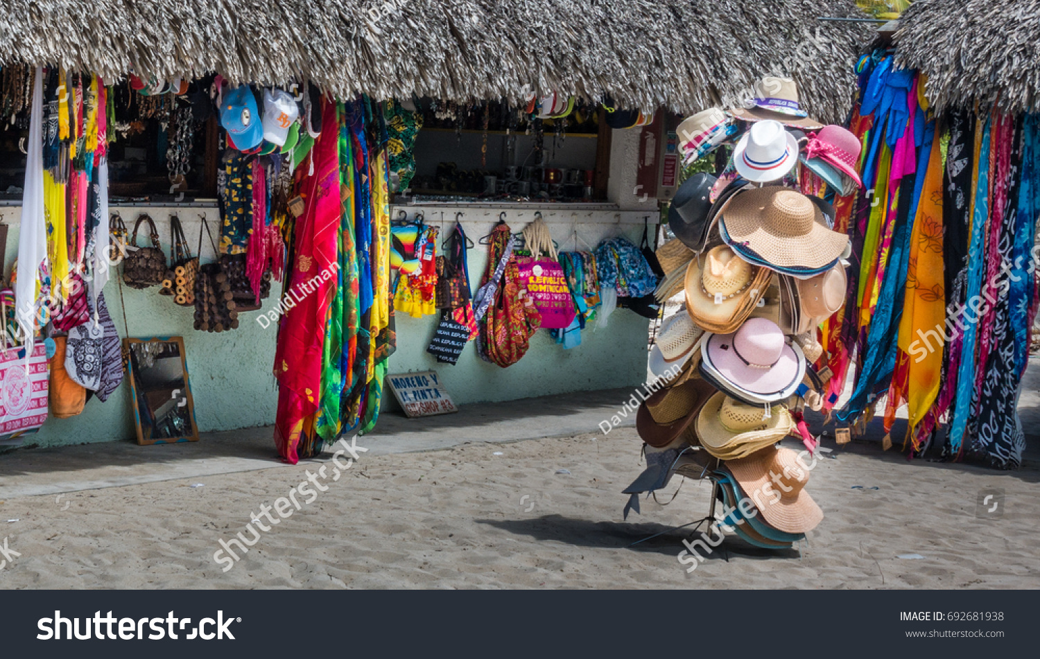 Isla Catalina, Dominican Republic - July 27, 2017: Colorful garments and hats on display in front of beach side gift shops thatched huts in a small village on Catalina Island in the Caribbean Sea.