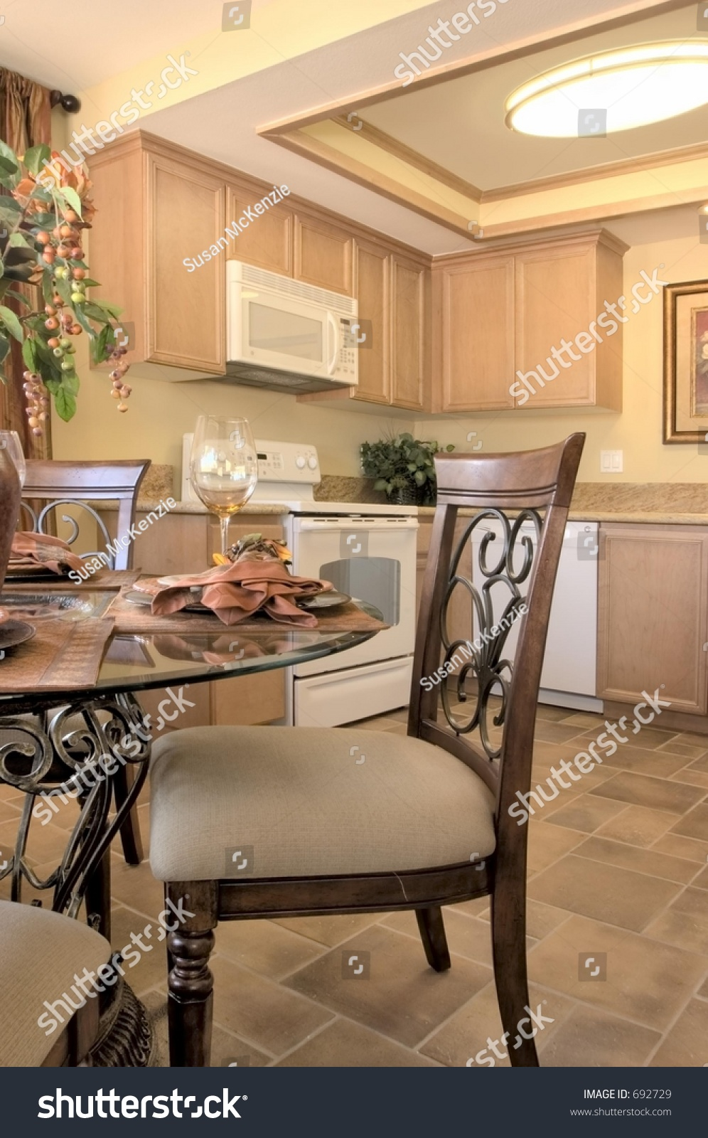 kitchen island table with 4 chairs modern kitchen with island table four chairs fridge stove and ceiling fan stock photo 692729 6077