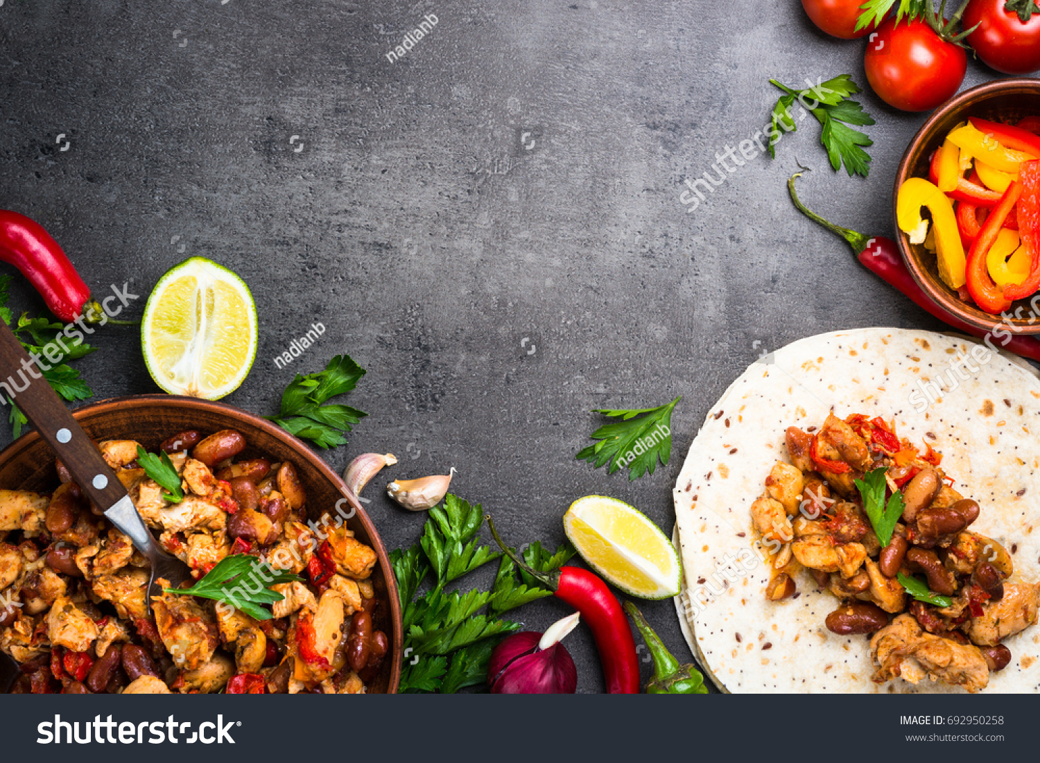 Cooking mexican taco meat beans vegetables stock photo royalty free cooking mexican taco with meat beans and vegetables at black stone table latin american food forumfinder Choice Image