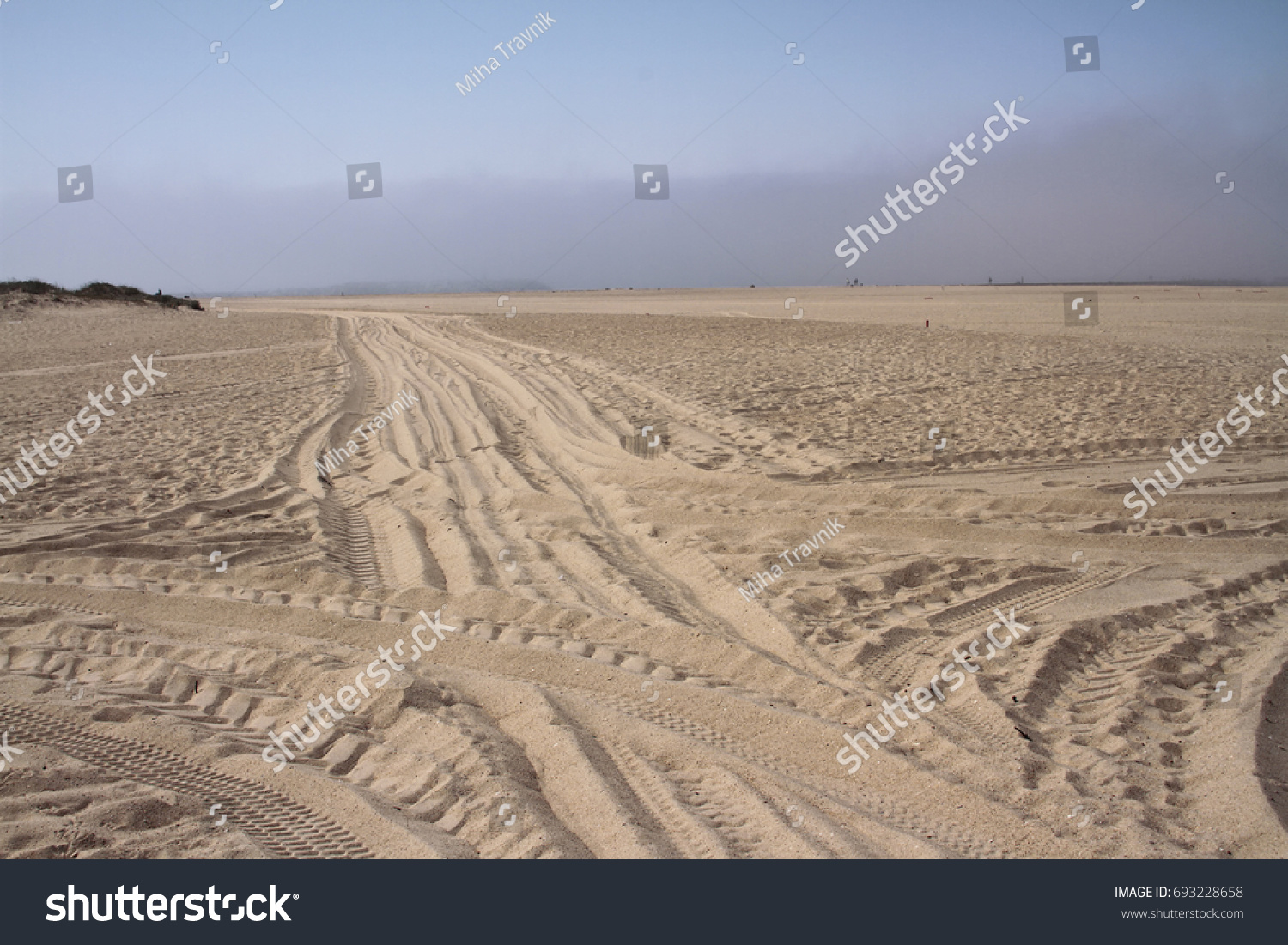 stock-photo-tire-marks-and-tracks-on-a-s
