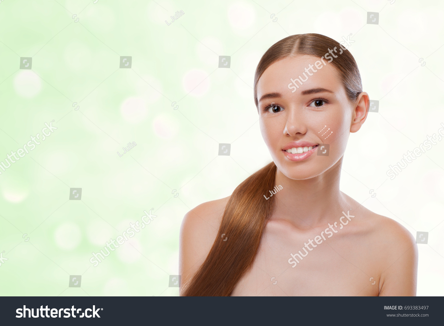 Amazing Girl With Beautiful Smile And Fresh Face Skin Looking At The Camera Close Up