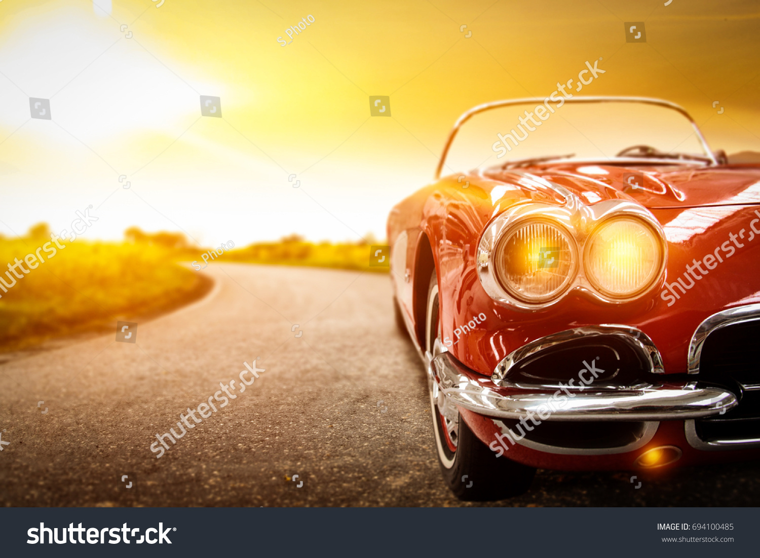 retro car on road and golden autumn space  #694100485