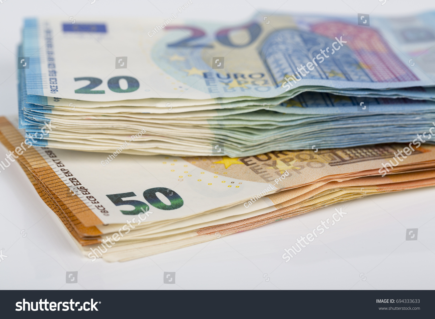 Pills bills paper 20 50 euro stock photo 694333633 shutterstock pills of bills paper 20 and 50 euro banknotes on white background symbol of biocorpaavc Images