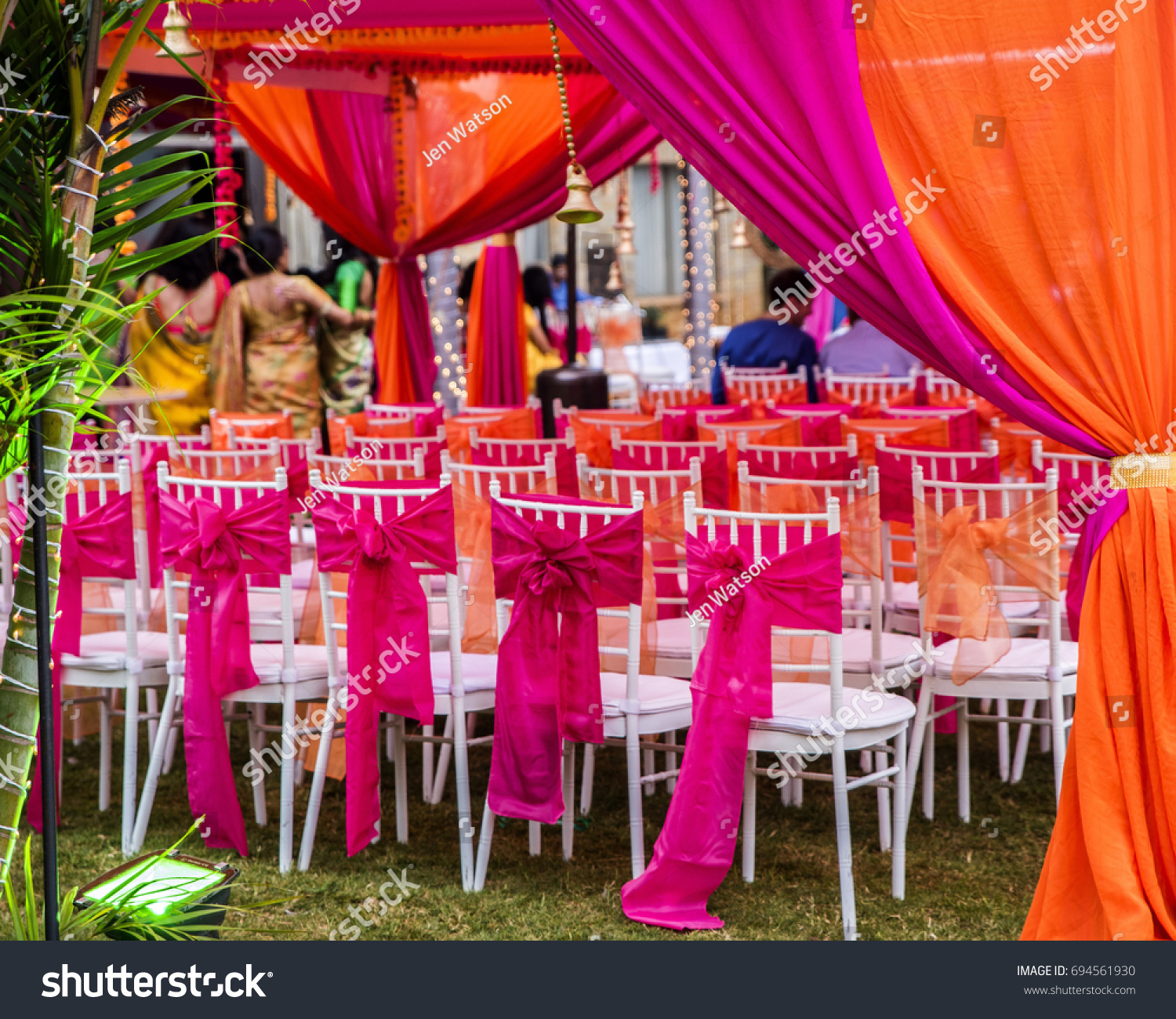 Colorful outdoor lawn tent and garden setting for Indian pre-wedding ceremony. Vibrant pink & Colorful Outdoor Lawn Tent Garden Setting Stock Photo 694561930 ...