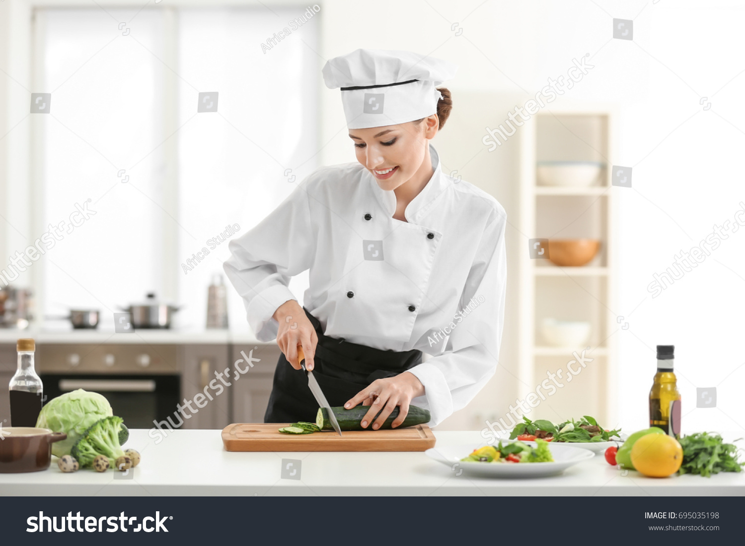 Young Female Chef Cooking Kitchen Stock Photo (Edit Now)- Shutterstock
